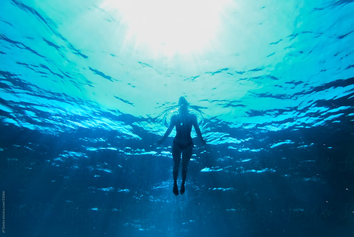 attractive underwater woman silhouette swimming stocksy united