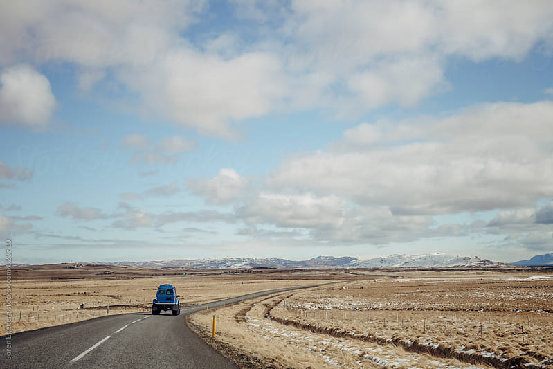 4WD vehicle driving on road in Iceland by Søren Egeberg Photography for Stocksy United