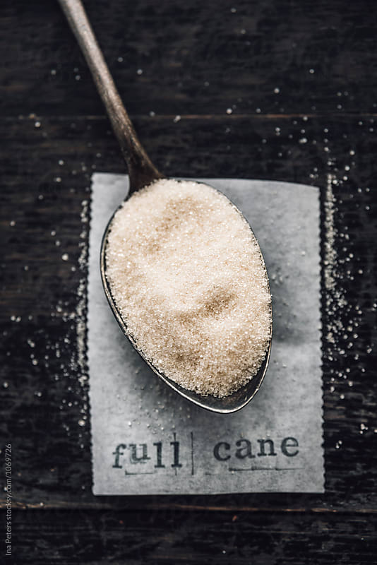 Food: Full cane sugar on a spoon by Ina Peters for Stocksy United