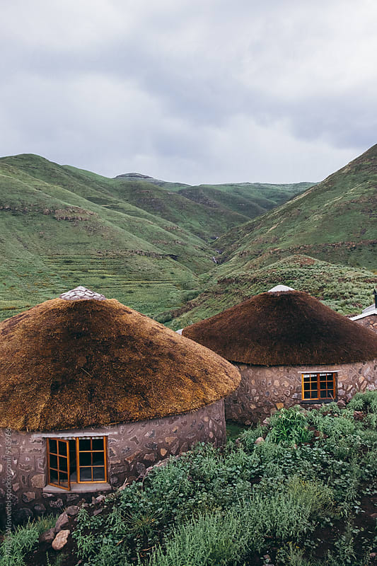 Rural stone and thatch huts in Lesotho by Micky Wiswedel for Stocksy United