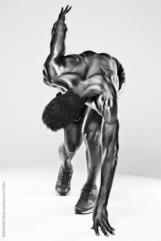 Sprinter african man in starting position by BONNINSTUDIO for Stocksy United