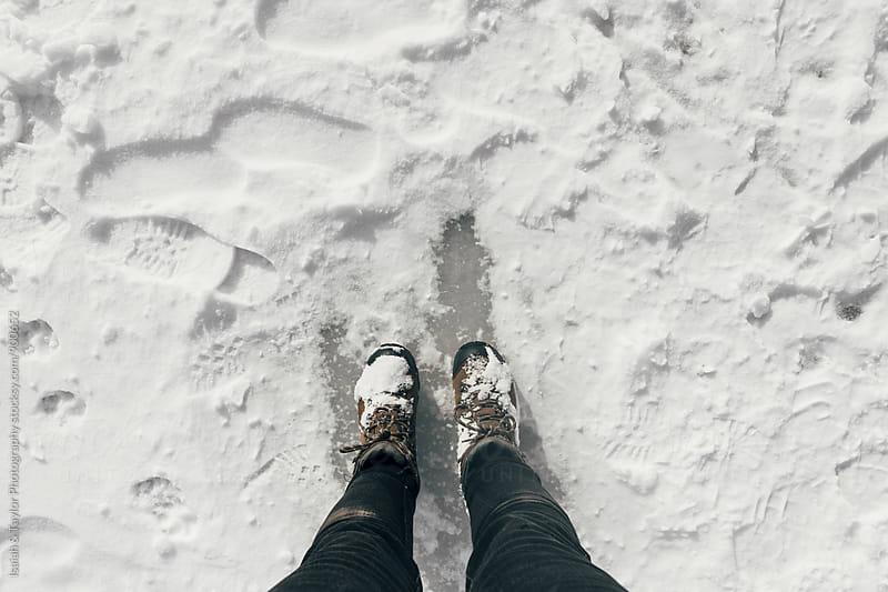 Hiking boots in snow by Isaiah & Taylor Photography for Stocksy United