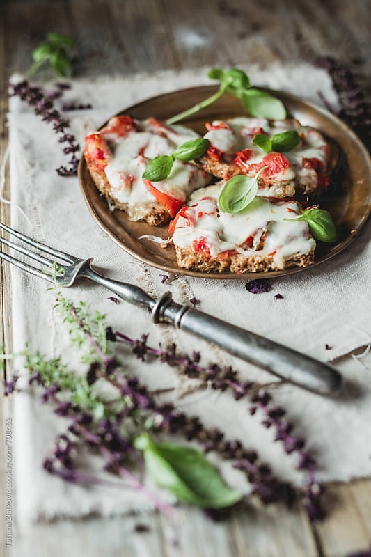 Sadnwiches with mozzarella and tomato by Tatjana Ristanic for Stocksy United