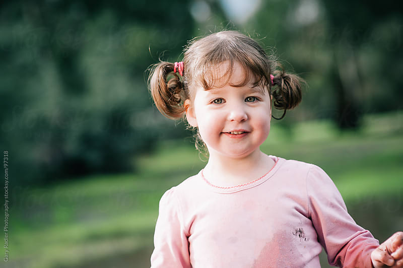 Girl of Nearly Three with Pigtails by Gary Radler Photography for Stocksy United