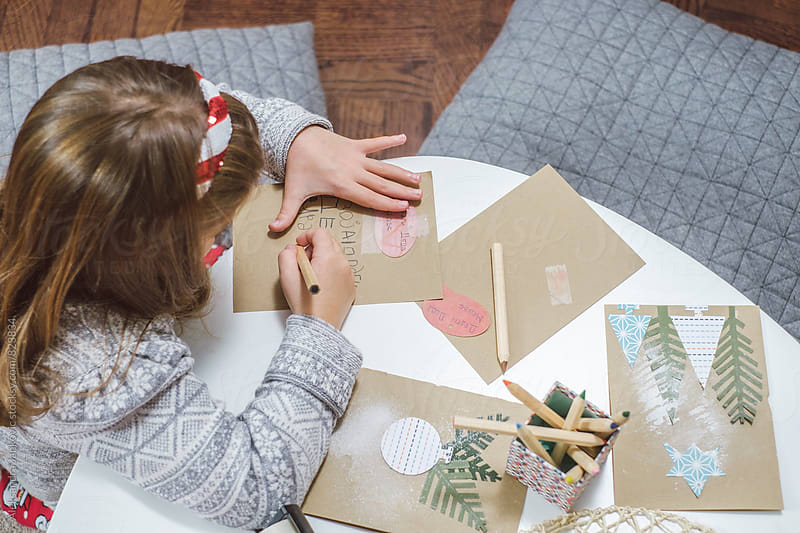 Little Girl Writting on the Christmas Card by Aleksandra Jankovic for Stocksy United