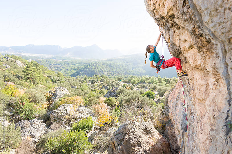 Young female rock climber on a difficult climbing route by RG&B Images for Stocksy United