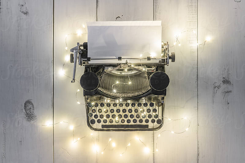 Antique Typewriter Illuminated by String Lights by suzanne clements for Stocksy United