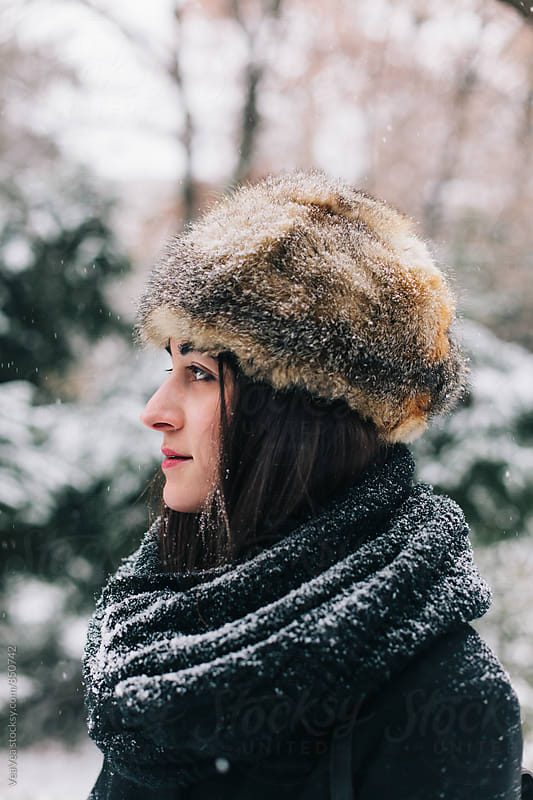 Portrait of a beautiful brunette woman with fur hat  by VeaVea for Stocksy United