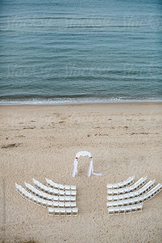 Empty rows of chairs setup before wedding - vertical by Matthew Spaulding for Stocksy United