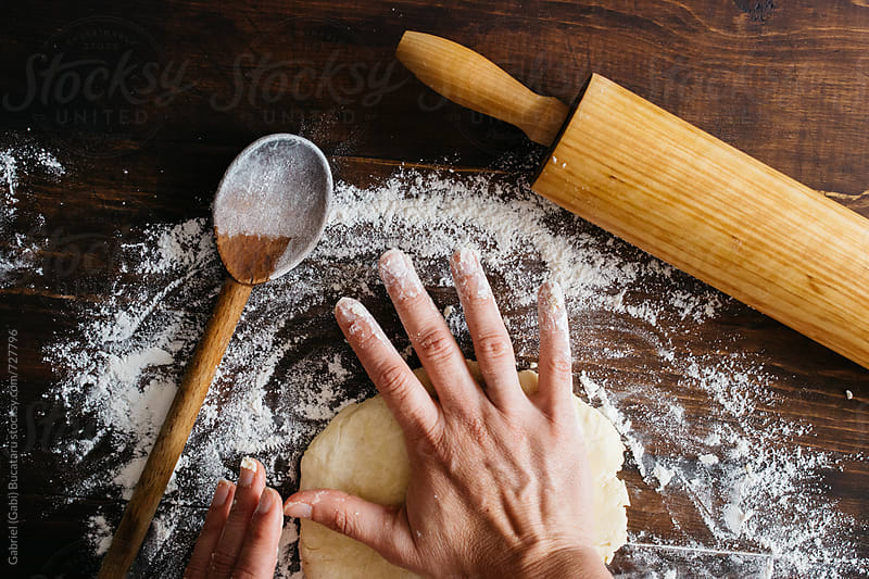Woman's hands flattening pie dough by Gabriel (Gabi) Bucataru for Stocksy United