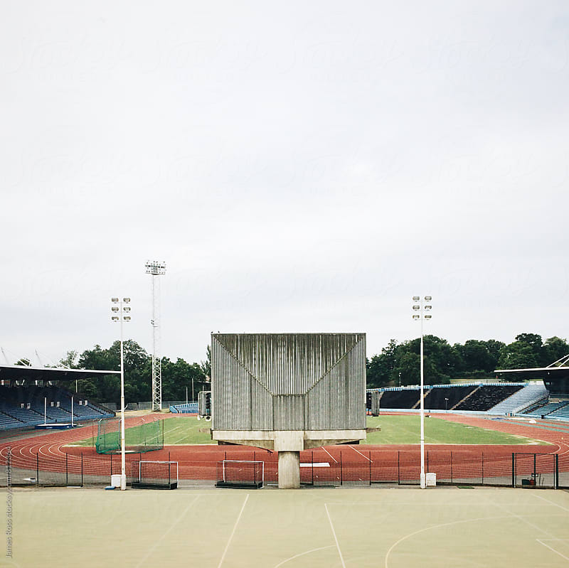 An empty athletics track by James Ross for Stocksy United