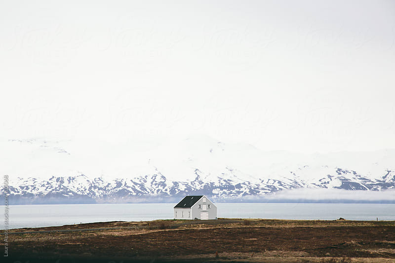 Small House On The Edge Of A Lake In Iceland by Laura Austin for Stocksy United