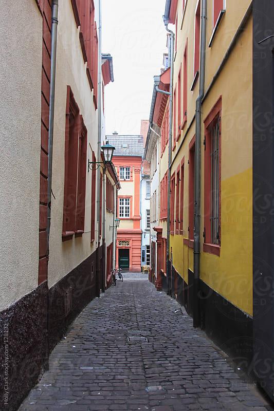 Narrow cobblestone street in an old German city, Heidelberg, Baden-Württemberg by Holly Clark for Stocksy United