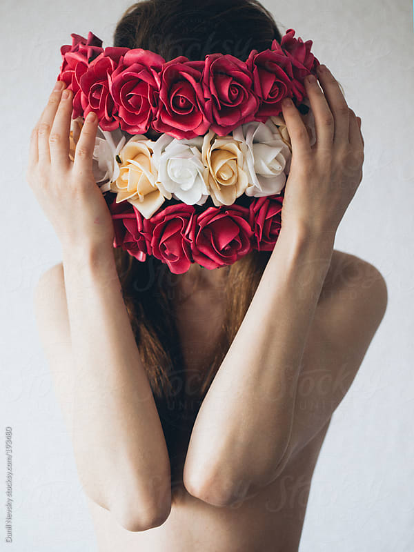 Female with flowers closing the face by Danil Nevsky for Stocksy United