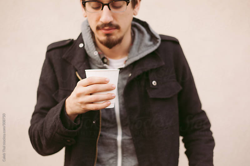Man with Coffee by Caleb Thal for Stocksy United