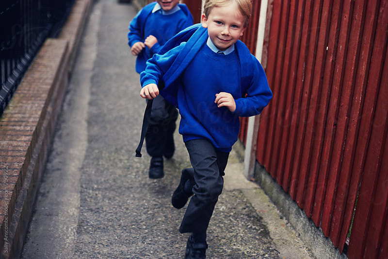 Children running to school by sally anscombe for Stocksy United