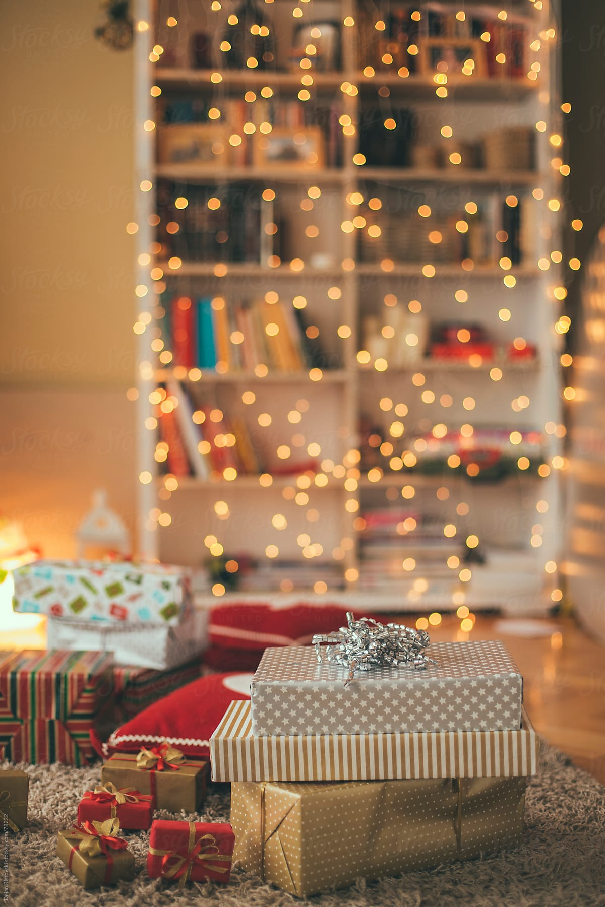 Living Room Decorated With Christmas Lights And Presents Stocksy