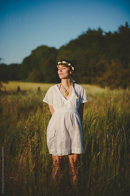 a bohemian bride in a meadow by Christian Zielecki for Stocksy United