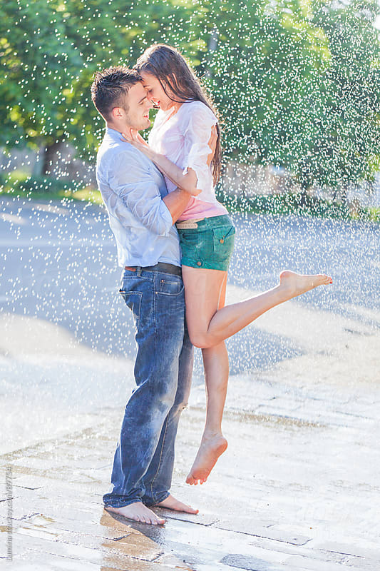 Couple Kissing in the Rain by Lumina for Stocksy United