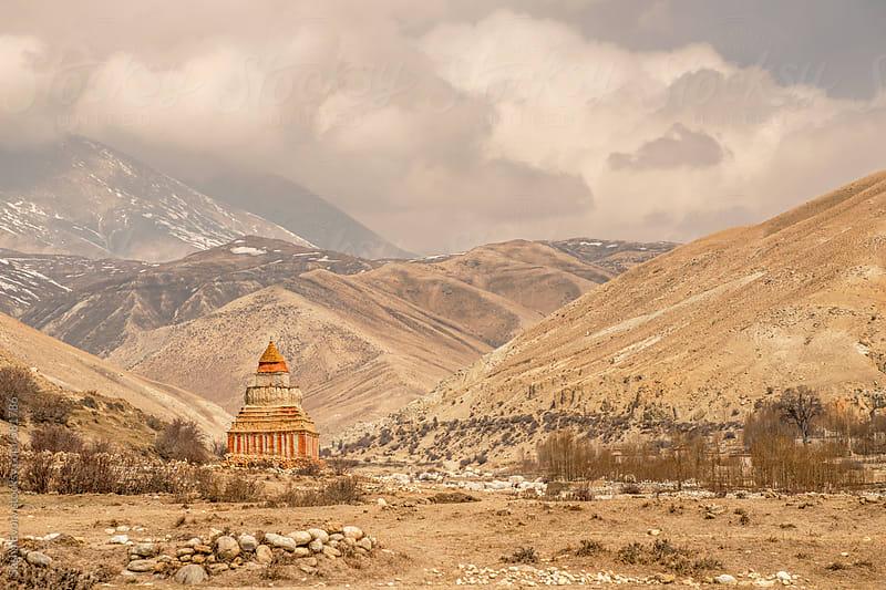 Ancient buddhist stupa among Himalaya mountains   by Sasha Evory for Stocksy United