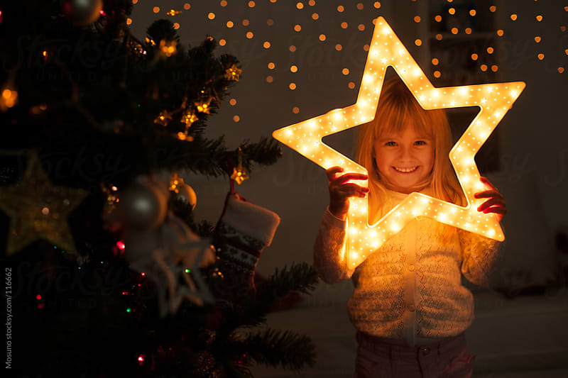 Cute girl Holding Christmas Star by Mosuno for Stocksy United