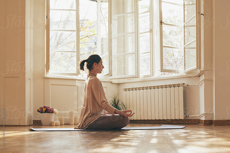 Woman Meditating in the Lotus Position  by Lumina for Stocksy United