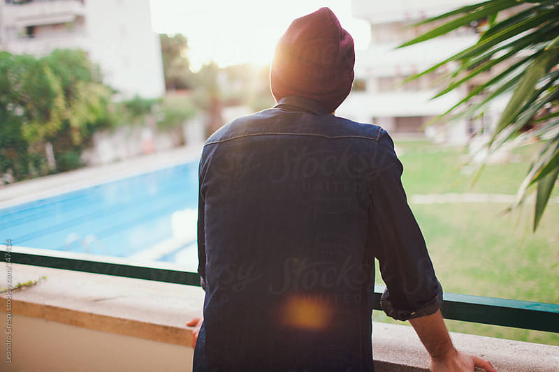 Man's back on balcony by Leandro Crespi for Stocksy United