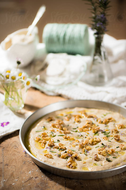 focaccia with walnuts and rosemary by Laura Adani for Stocksy United