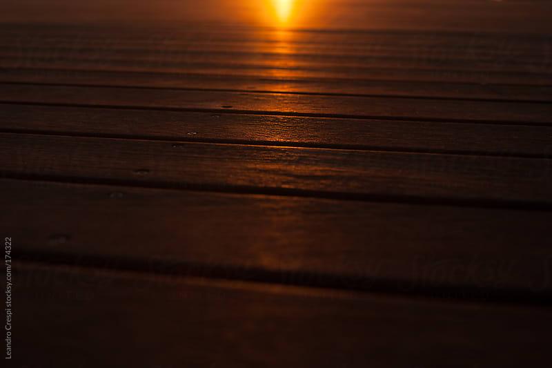 sunset light over wooden platform by Leandro Crespi for Stocksy United