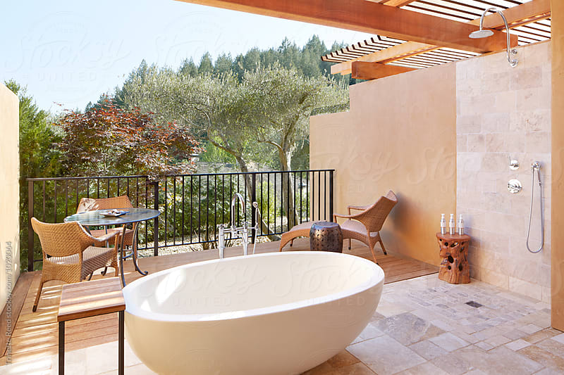 Outdoor patio with concrete bathtub by Trinette Reed for Stocksy United