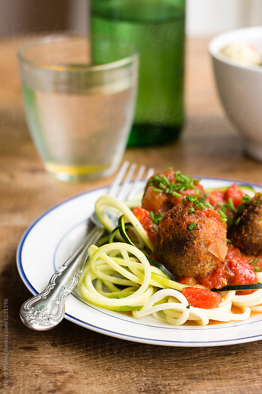 Falafel Balls with Marinara Sauce on Zucchini Noodles by Harald Walker for Stocksy United