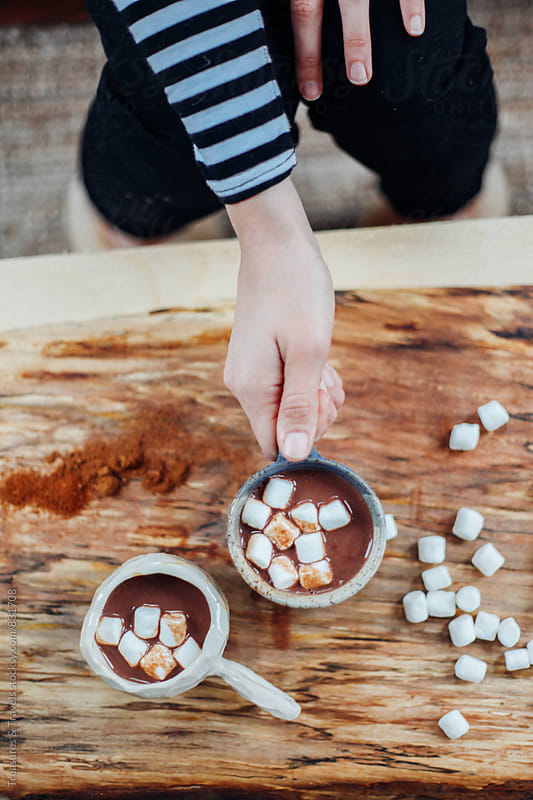 hot chocolate and marshmallows from above  by Treasures & Travels for Stocksy United