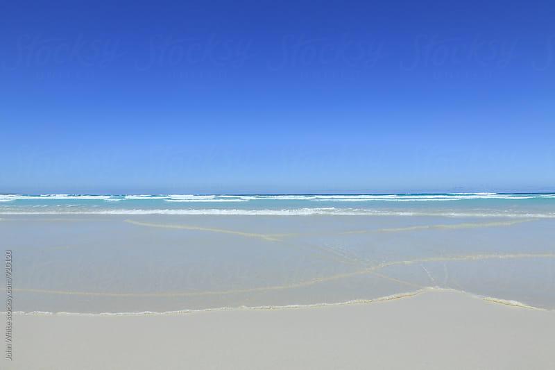 Remote beach with blue sky. Australia. by John White for Stocksy United