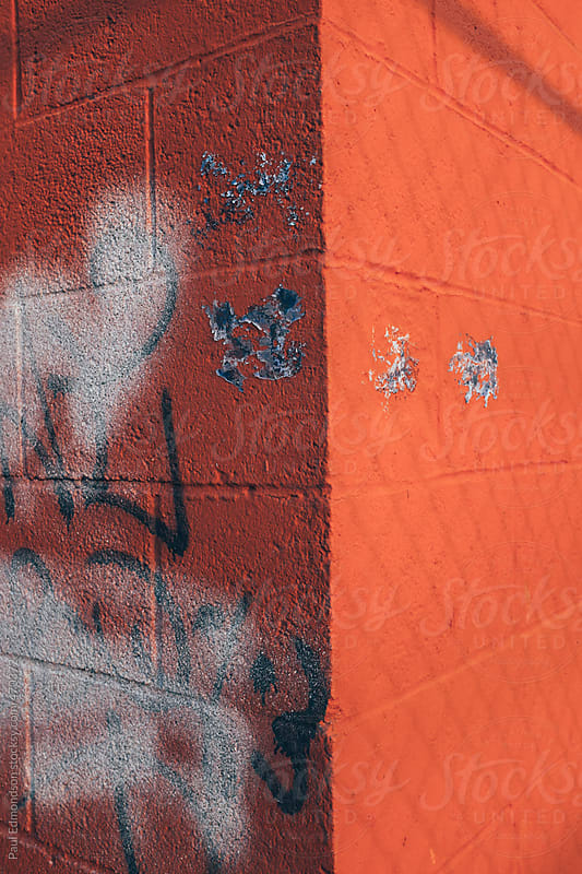 Graffiti and spray paint on building wall, close up by Paul Edmondson for Stocksy United