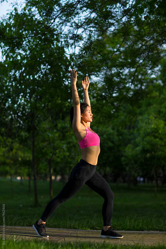 young asian woman doing exercise in the park by Bo Bo for Stocksy United