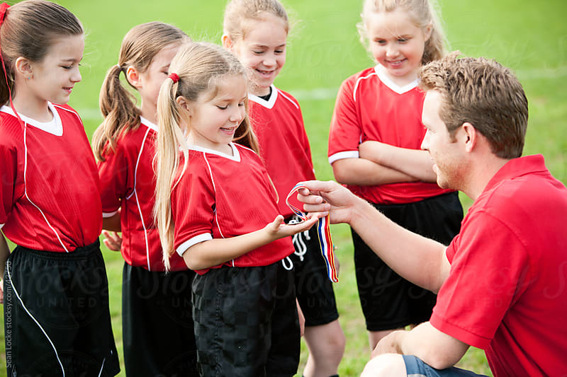 Soccer: Girl Gets Soccer Award by Sean Locke for Stocksy United