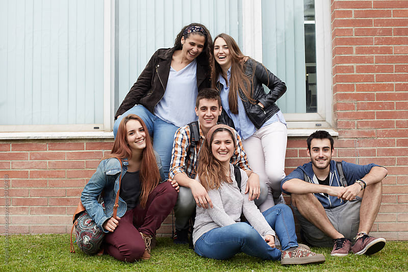 Group portrait of young people friends  by Miquel Llonch for Stocksy United