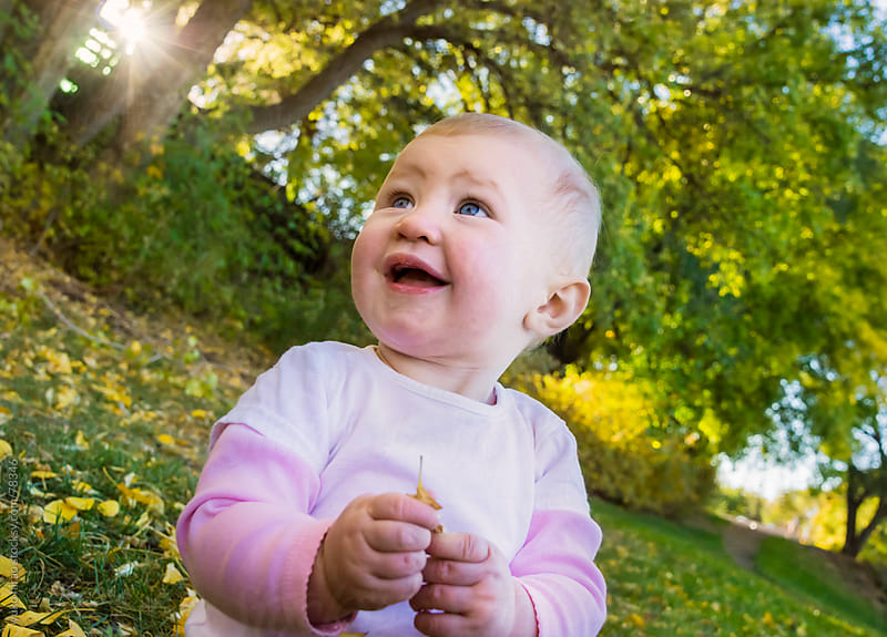 Smiling baby in autumn park by yuko hirao for Stocksy United