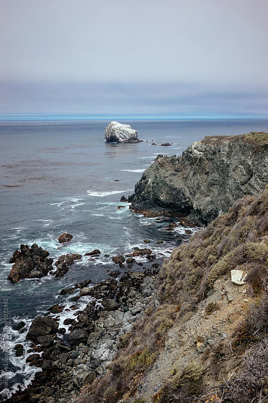 White capped rock, off the coast of California. by Christian McLeod for Stocksy United
