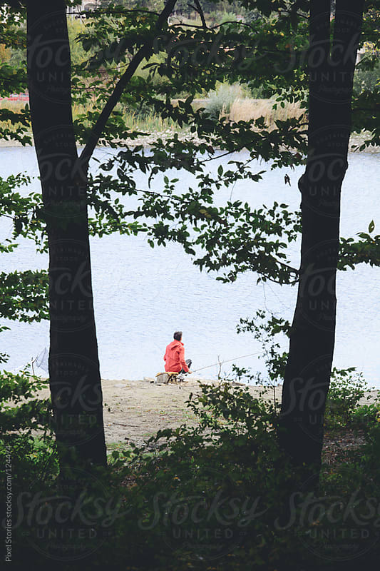 Person fishing by Pixel Stories for Stocksy United