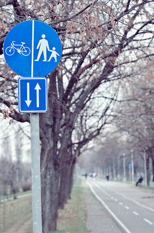 Sign for bicycles and pedestrians in park by Marija Anicic for Stocksy United