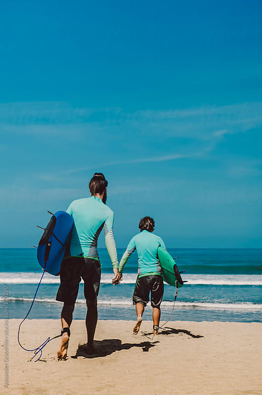 Walking To The Surf by Alexander Grabchilev for Stocksy United