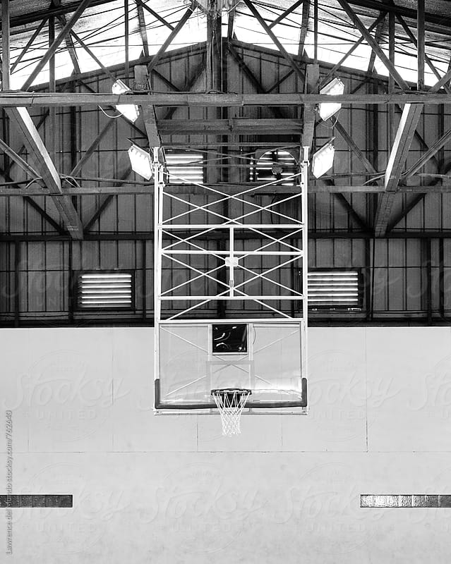 Vertical shot of indoor basketball court facility by Lawrence del Mundo for Stocksy United