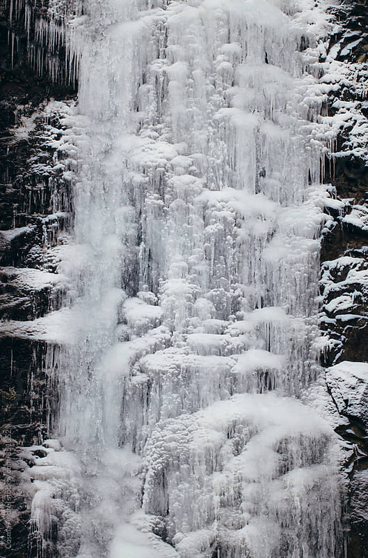 Frozen waterfall by Cosma Andrei for Stocksy United