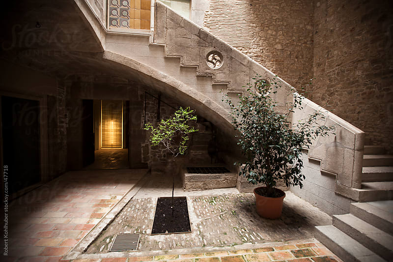 Old courtyard in Gerona, Spain by Robert Kohlhuber for Stocksy United