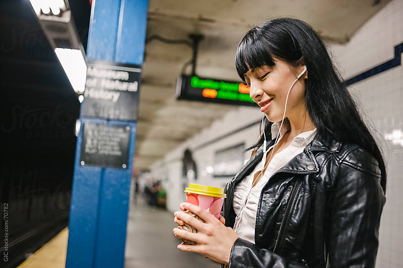 Woman waiting train in a subway station by GIC for Stocksy United