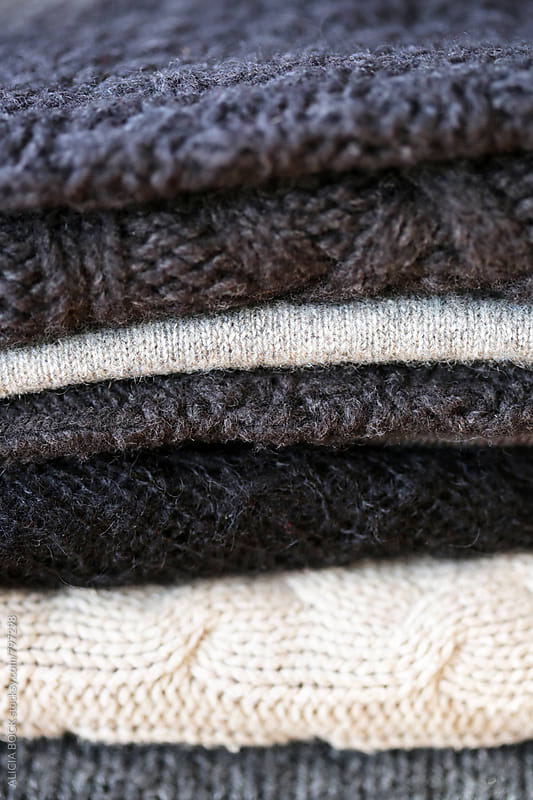 A Close Up Of A Group Of Gray Knit Sweaters by ALICIA BOCK for Stocksy United