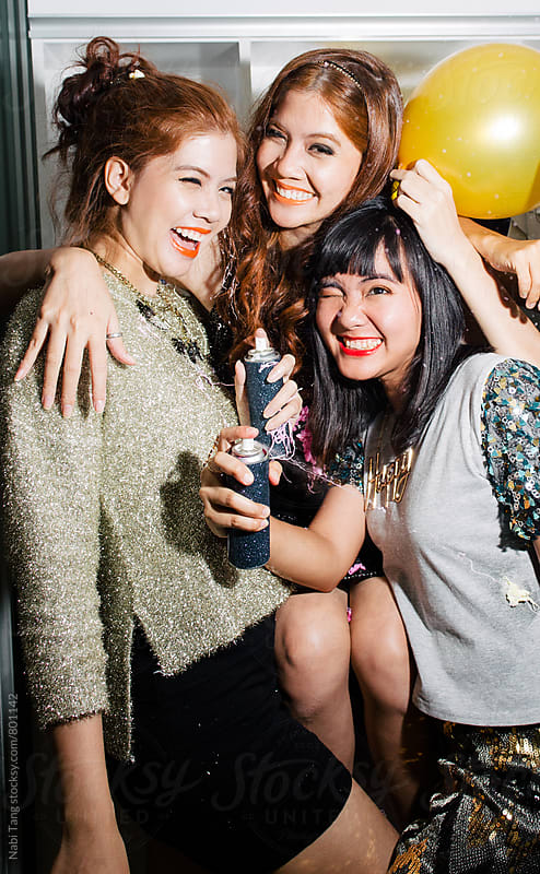 Asian young women in new year's eve party by Nabi Tang for Stocksy United