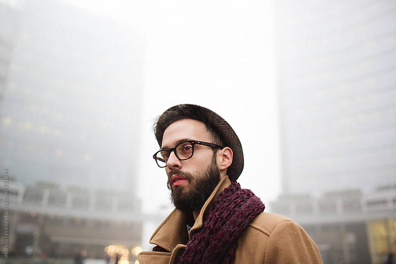 Portrait of young man with a beard outdoors by michela ravasio for Stocksy United