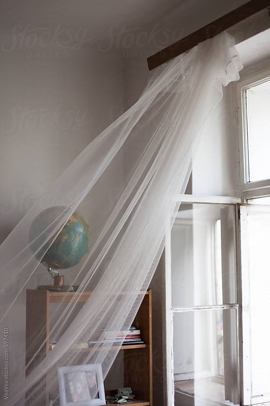 White curtain on the window blown by the wind by marija mandic for